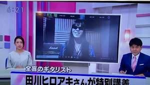 KRYニュースライブの冒頭でキャスターの紹介のバックで私が映っている写真。